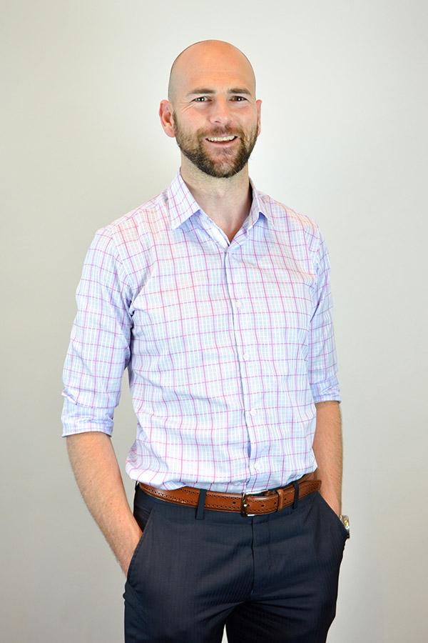 Bearded bald man smiling